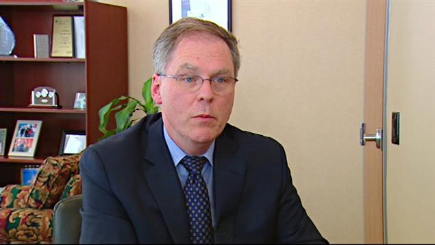Le ministre de l'Environnement, John Wilkinson