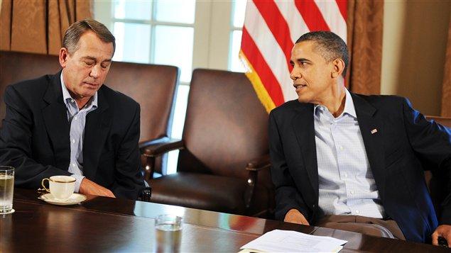 Le président républicain de la Chambre des représentants, John Boehner, en compagnie de Barack Obama, réunis à la Maison-Blanche, le 23 juillet 2011.