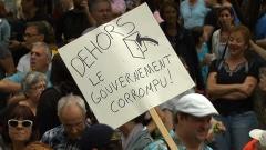 Manifestants réclamant une enquête publique sur l'industrie de la construction, à Montréal