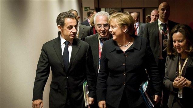 Le président français Nicolas Sarkozy et la chancelière allemande Angela Merkel à l'ouverture des discussions à Bruxelles, jeudi