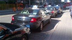Une compagnie de taxi d'Ottawa congédie 60 téléphonistes et blâme Uber