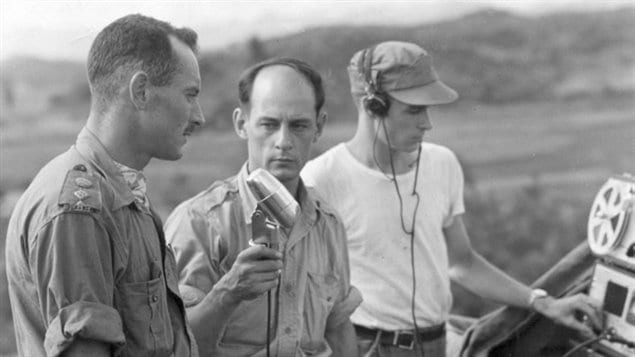 Radio-Canada International journalist Rene Levesque interviews Lt.-Col. Jacques Dextraze in Korea in 1951, while technician Norman Eaves looks on. (National Defence/Radio-Canada/CBC Still Photo Collection)
