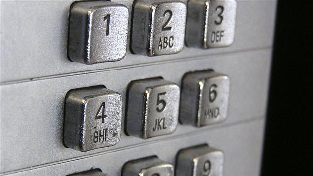 Le clavier d'un téléphone public