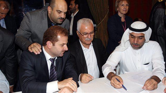 Des membres de la Coalition nationale syrienne réunie à Doha au Qatar
