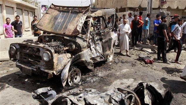 Site d'un attentat à la voiture piégée dans le quartier de Kamaliya, à Bagdad, en Irak