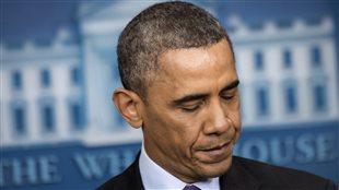 Le président américain, Barack Obama, rend hommage à Nelson Mandela le 5 décembre 2013 à la Maison-Blanche.