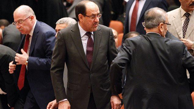 Le président d'Irak Nouri Al-Maliki, au centre, lors de la séance du Parlement, le 1er juillet, qui a été très chaotique.