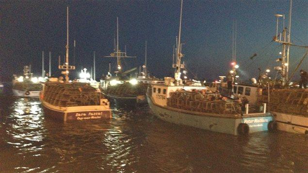 Coup d'envoi de la saison de pêche au homard aux Îles-de-la-Madeleine, au quai de Grande-Entrée.
