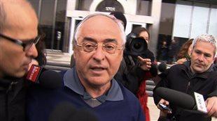 L'ex-maire de Mascouche, Richard Marcotte, à sa sortie du quartier-général de la Sûreté du Québec à Montréal, au printemps 2012