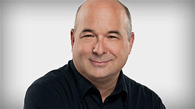 Michel C. Auger, animateur de l'émission Midi info diffusée sur ICI Radio-Canada Première