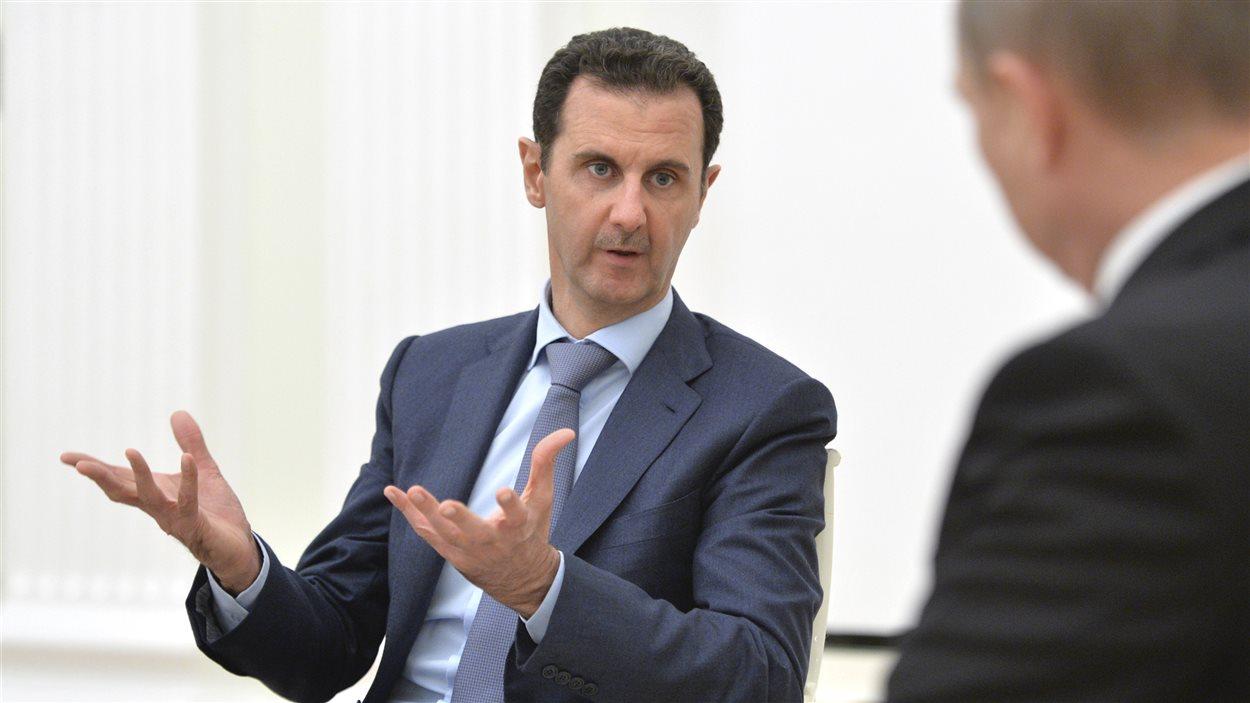 Le président Bachar al-Assad lors d'une rencontre avec le président russe, Vladimir Poutine