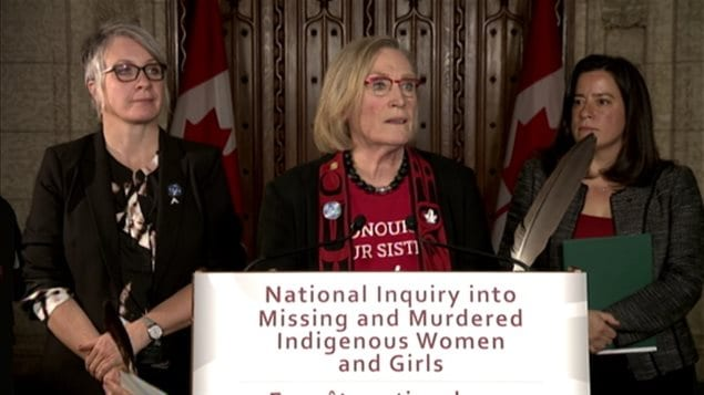 Indigenous and Northern Affairs Minister Carolyn Bennett (C) announced the first steps for her government's promised inquiry into missing and murdered indigenous women Tuesday afternoon in Ottawa.