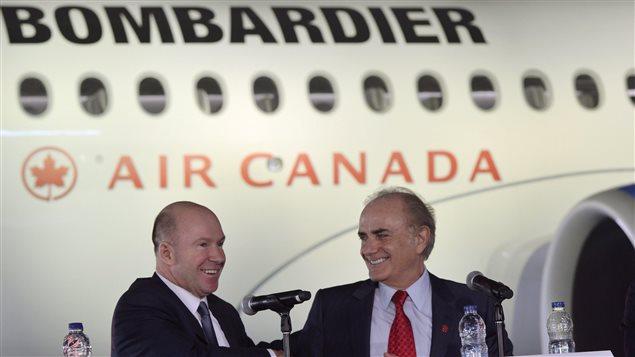 Le président et chef de la direction de Bombardier, Alain Bellemare, serre la main du président et chef de la direction d'Air Canada, Calin Rovinescu lors d'une conférence de presse le 17 février 2016.