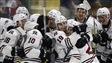Les joueurs des Huskies de Rouyn-Noranda célèbrent leur victoire face aux Rebels de Red Deer