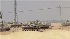 Kurdes et Turcs rivalisent pour la conquête d'un bastion de l'EI