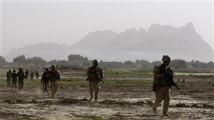 Canadian soldiers from 4th platoon, B company 1st Battalion, Royal 22nd Regiment walk during a patrol in the Panjwai district of Kandahar province southern Afghanistan, June 16, 2011.