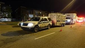 Les enquêteurs sur la scène de crime à Laval