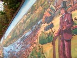 Une fresque qui illustre l'histoire de la ville de Trois-Rivières.