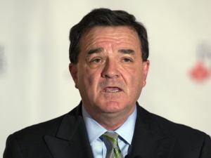 Le ministre des Finances, Jim Flaherty, devant l'Empire Club de Toronto