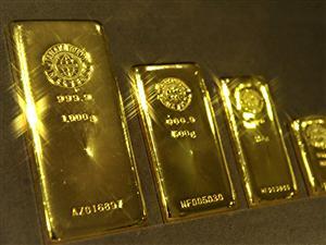 Lingots d'or dans un écrin