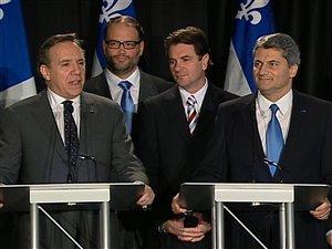 Gérard Deltell et François Legault annoncent officiellement la fusion de l'ADQ et de la CAQ.