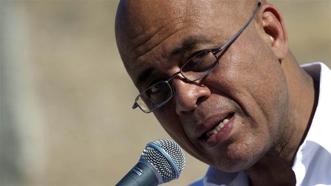 Le président haïtien, Michel Martelly, prend la parole durant une cérémonie de commémoration des cinq ans du séisme à Titanyen.