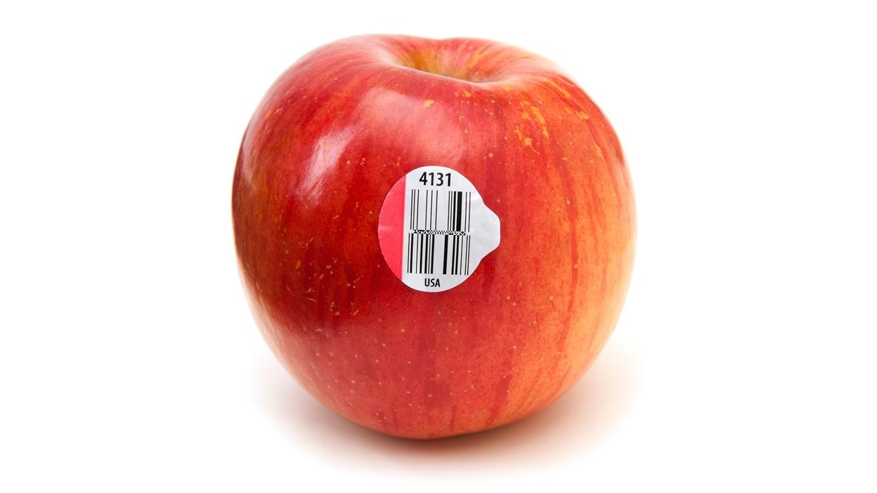 Une pomme et son étiquette à code numérique