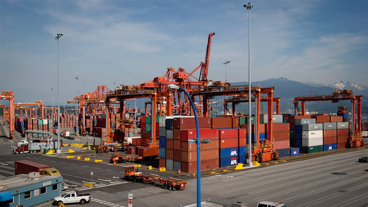 Cargo containers are stacked as cranes tower overhead at Port Metro Vancouver's Centerm container facility in Vancouver, B.C., on May 10, 2013.