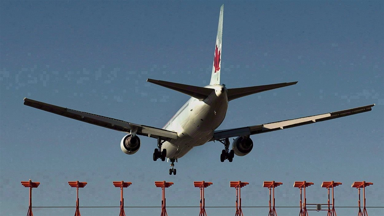 An Air Canada passenger jet is shown landing at Halifax Stanfield International Airport in Halifax on Jan. 21, 2013. A 47-year-old Alberta man has been charged after an incident on board an Air Canada flight en route to India was diverted back to Toronto early Wednesday morning.